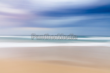 blurred abstract landscape of beach sunrise