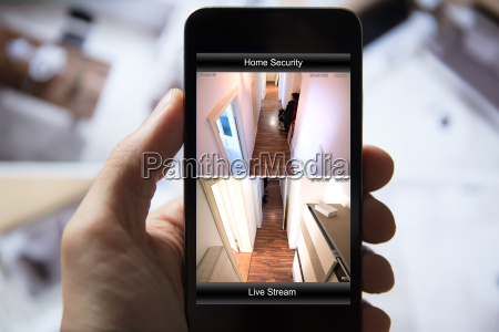 person using home security system on