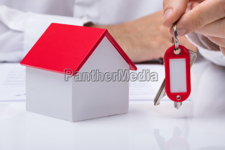 hand holding house keys with house