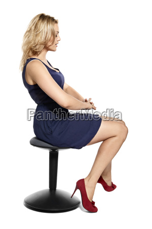 sexy young blonde woman sitting on