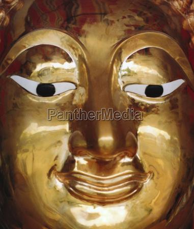 object religion art colour asia face