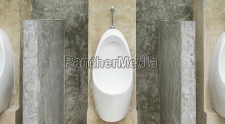 white urinal men in men public
