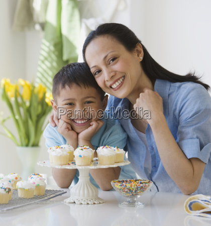 asian mother and son with cupcakes