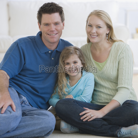 portrait of family sitting on floor