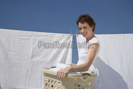 woman hanging laundry on clothes line