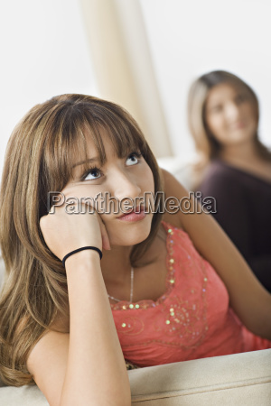 angry daughter sitting with mother on