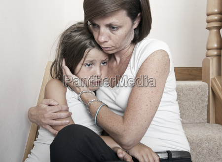 mother consoling sad daughter 6 7