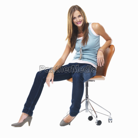 attractive woman sitting on chair and