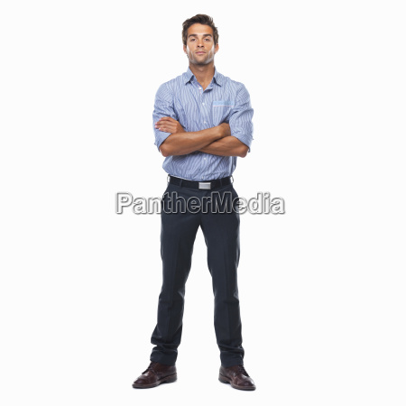 confident business man standing with arms