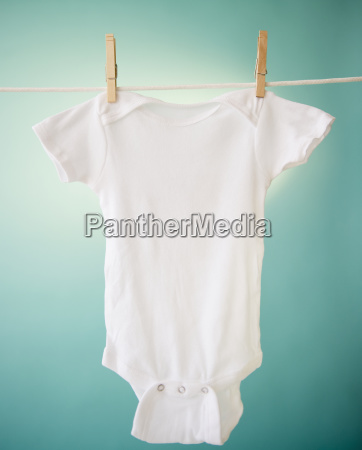 close up of baby clothes hanging
