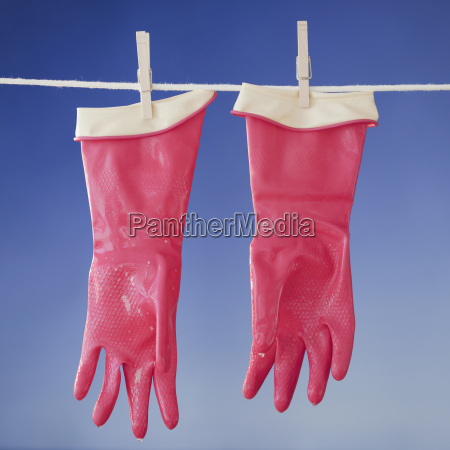 rubber gloves drying on clothesline