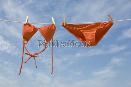 bikini hanging from clothesline