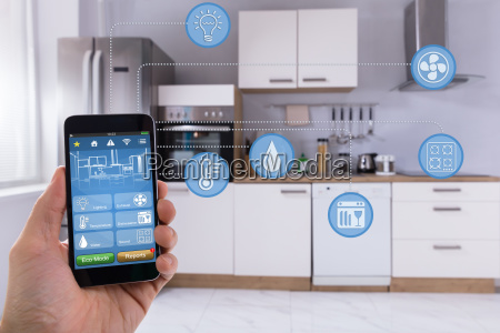 person using smart home application on
