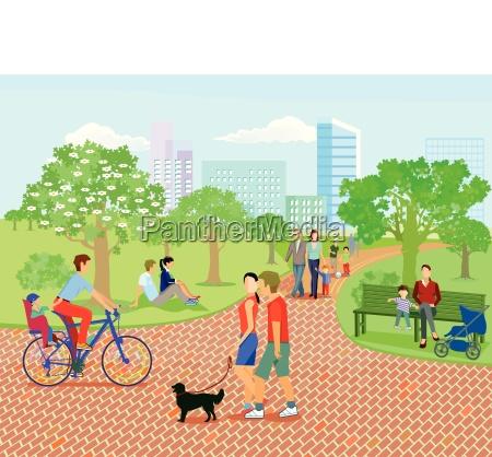 rodziny i rodzice odpoczywaja w parku