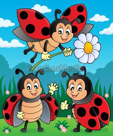 happy ladybugs on meadow image 2
