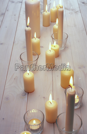 white candles on a wooden table