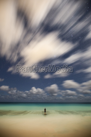 lone man standing at beach and