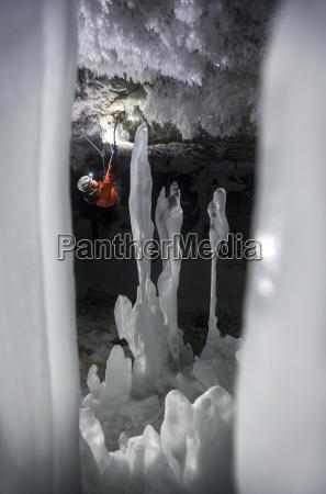 ice climber in ice cave kootenay