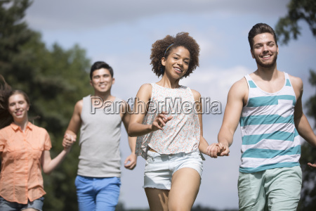 portrait of young couples running through