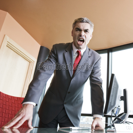 an angry caucasian businessman in a