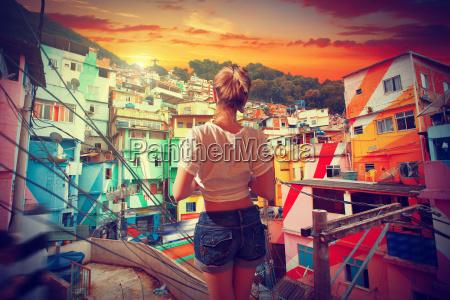 brazilian woman standing in the favela