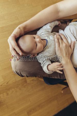 mother giving newborn a belly massage