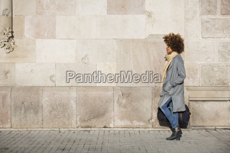 side view of woman carrying bag