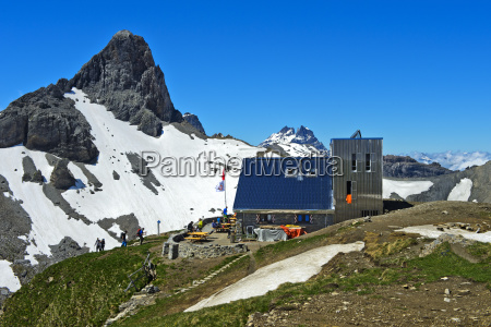 blue house building houses bucolic mountains
