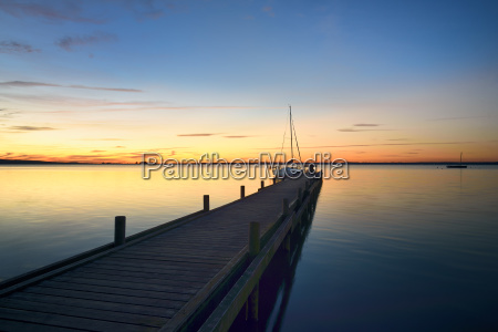 jetties with sailboats at abendrot steinhuder