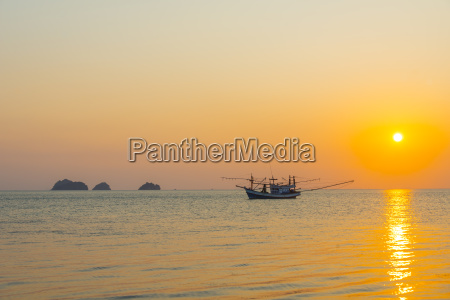 boat in the sea at sunset