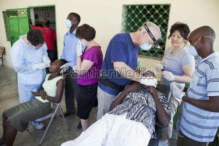 a dentist volunteers his dentistry to