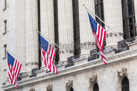 american flags waving on exterior of