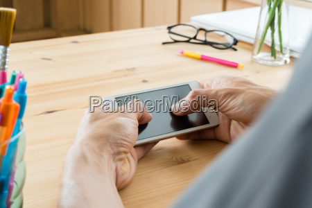 gray shirt businessman chat horizontal smartphone