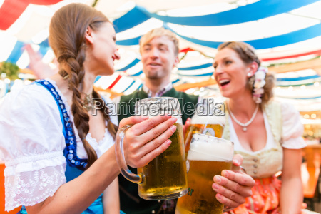 friends with beer glasses at bavarian