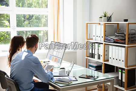 two businesspeople sitting in office