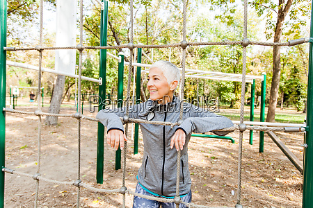 fit senior woman exercise at outdoor
