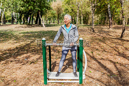 healthy mature woman workout at outdoor