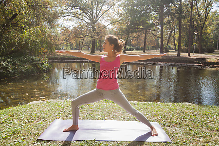 woman performing yoga exercise in warrior