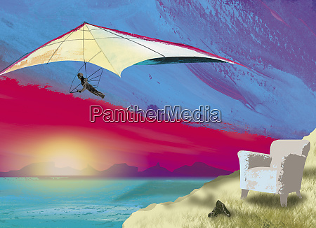 armchair on cliff with hang glider