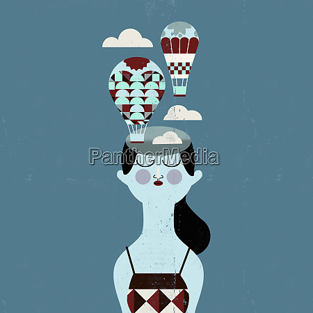 woman with hot air balloons coming