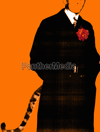businessman in suit with tigers tail