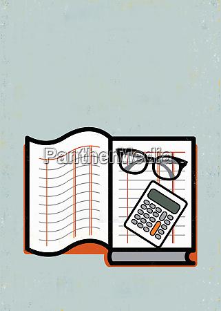 eyeglasses and calculator on ledger book