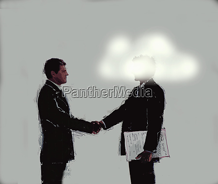 businessman shaking hands with man with