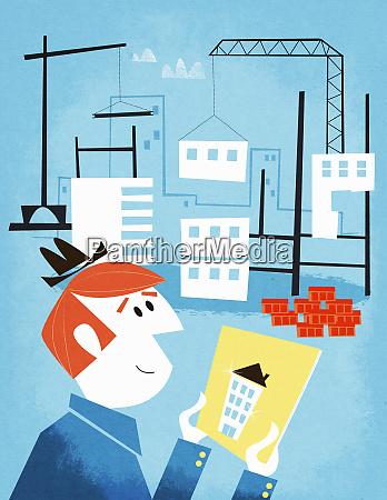 biznesmen gospodarstwa obraz domu na placu