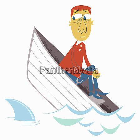AEngstlicher mann im sinkenden boot beobachtet