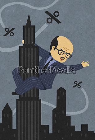 businessman as king kong clinging to
