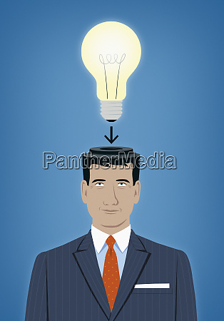businessman with light bulb fitting to