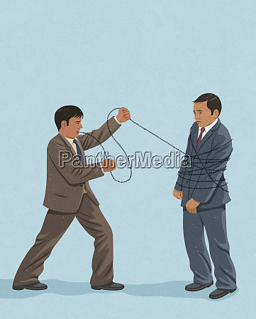aggressive businessman tying up unhappy man