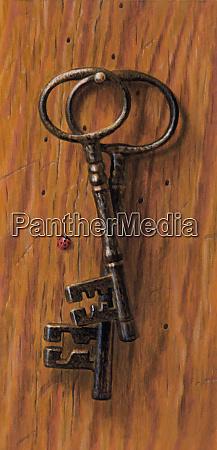 staromodne klucze wiszace na paznokciu