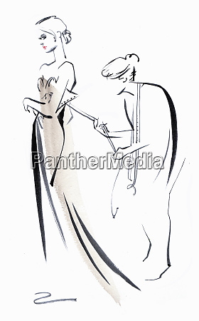 dressmaker fitting wedding dress on bride